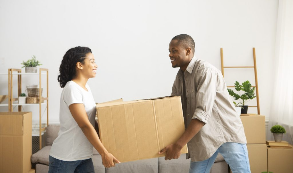 Couple carry out big box of home, make room for repairs